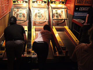 Play skee-ball at Full Circle Bar