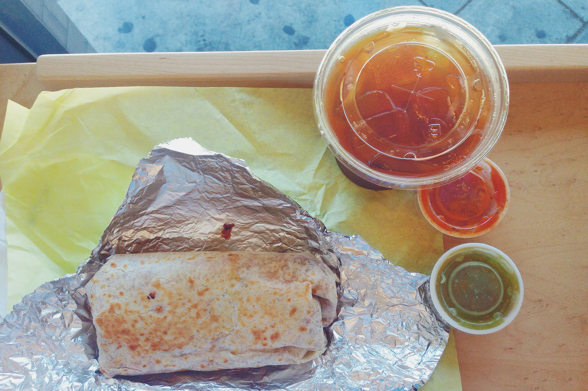 <p>Chorizo burrito and cold brew Stumptown coffee.</p>