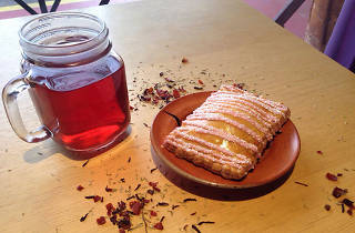 Tea and a raspberry pop pie.