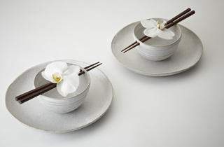 (Asian bowls with chopsticks by Maria de Haan)