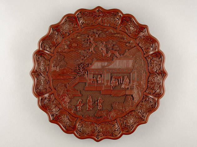 (Carved red lacquer on wood core, Yongle mark and period 1403-24, South China. Diameter 34.8 cm © The Trustees of the British Museum)