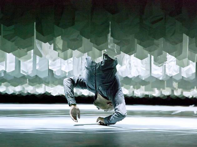 Akram Khan suspended above the stage in Desh