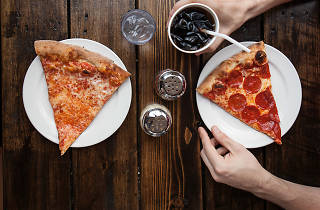 Get a pizza slice at Craft Pizza.