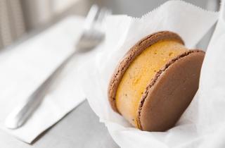 Pumpkin chocolate chip macaron ice cream sandwich at MILK