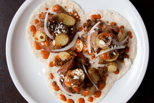 Beer-braised tongue tacos at Empellón Taqueria