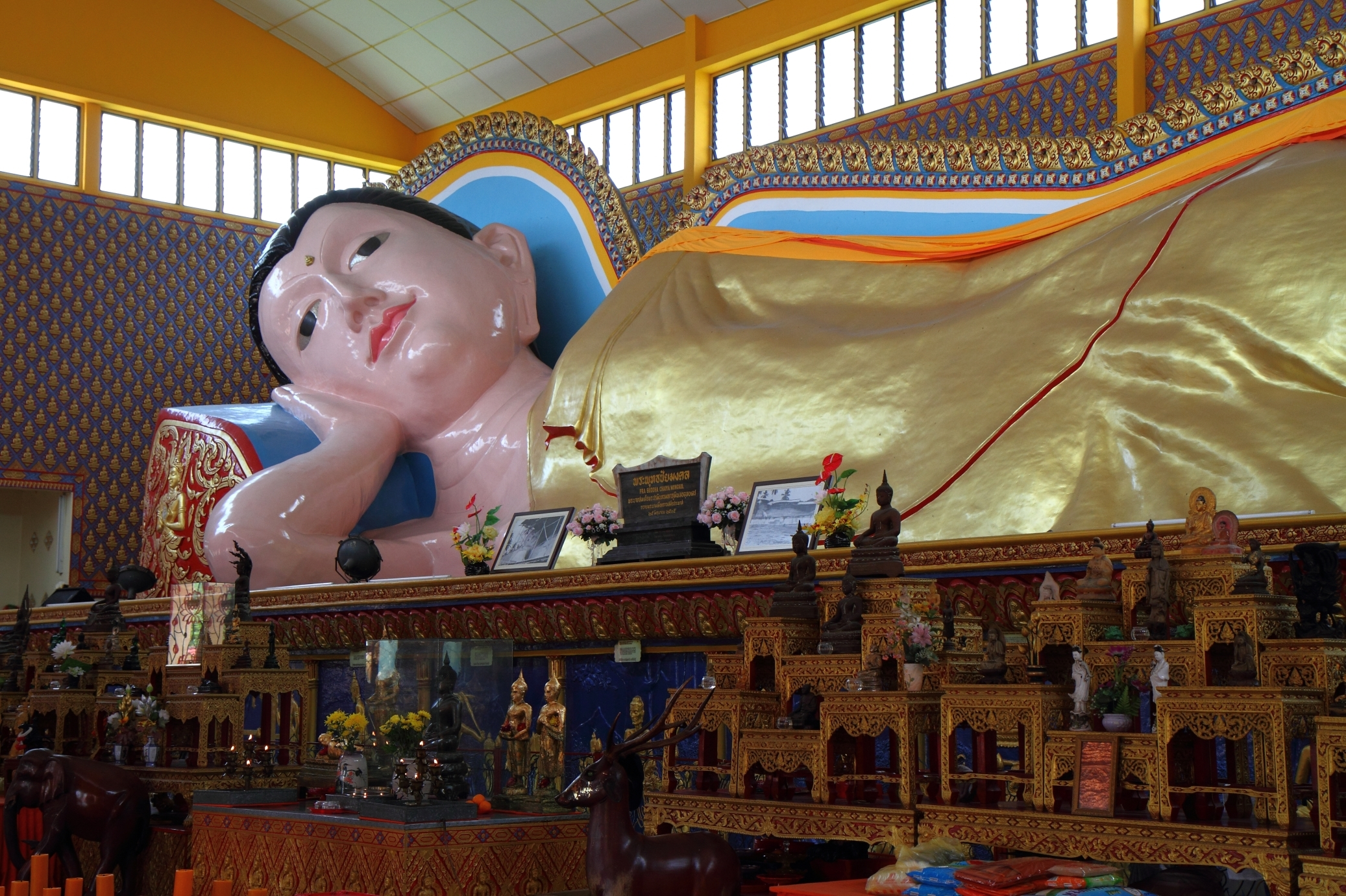 Marvel at one of Asia's largest reclining Buddha statues