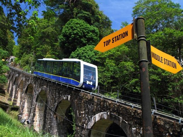 Hop on the funicular train up Penang Hill