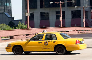 A taxi drives through the streets of Chicago.