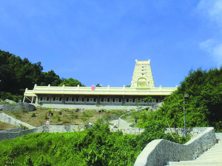 Climb the 500 steps to Waterfall Hilltop Temple