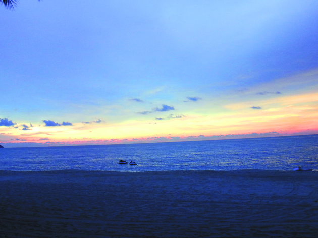 Enjoy Batu Ferringhi's romantic sunset with a friend