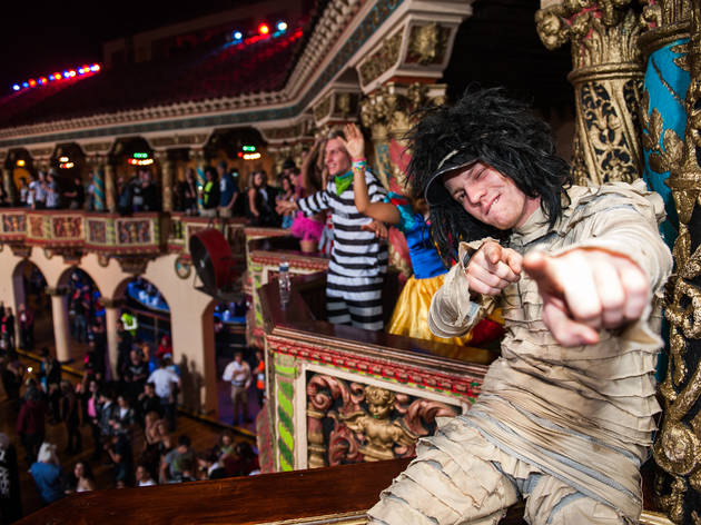 Costumed dancers get down at the 2014 Freaky Deaky Halloween party with headliner Flux Pavilion.