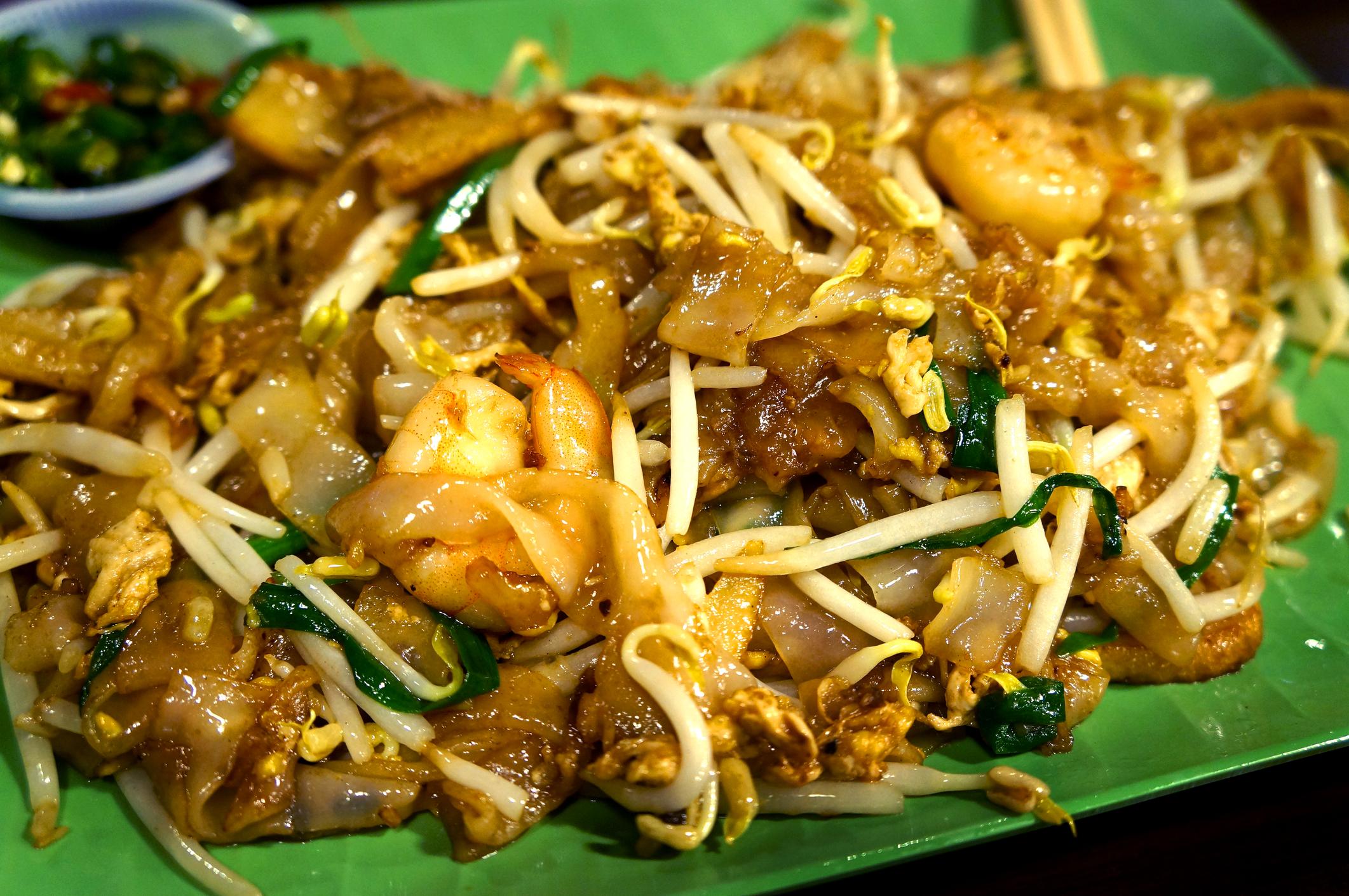 Savour the island's favourite stir-fry, char koay teow