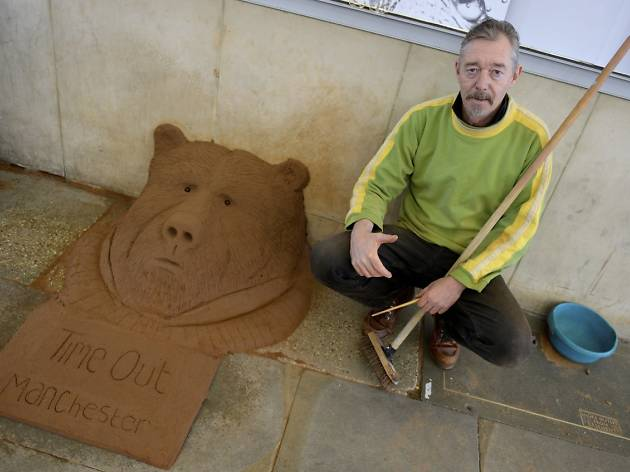 Larry the sandman with his Time Out Manchester bear sculpture