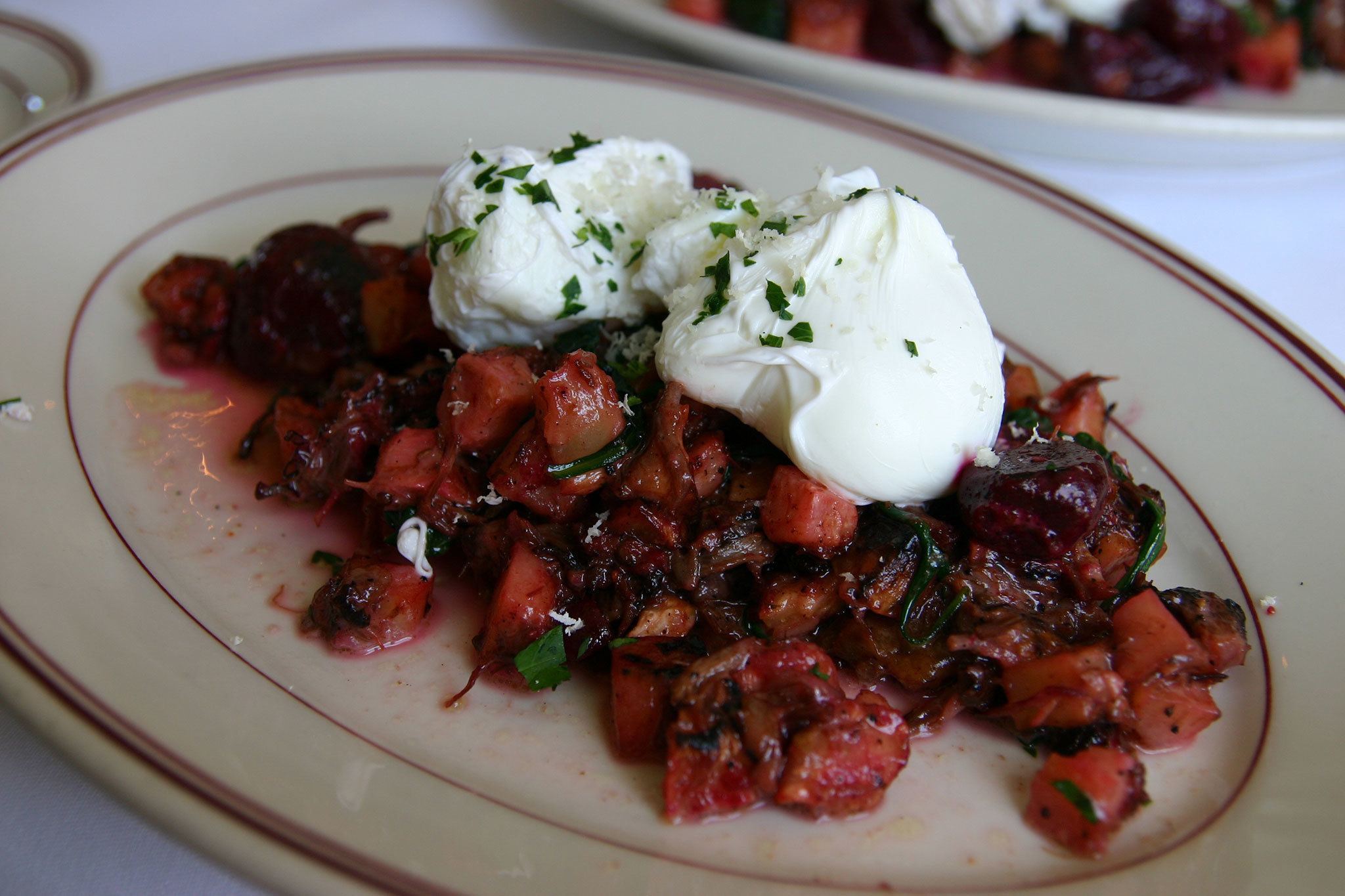 Oxtail Red Flannel Hash with poached eggs, beets and fresh horseradish at Presidio Social Club