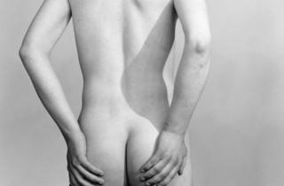 (Back view of standing figure, nude except for stockings, Anonymous photograph from the Kinsey Institute Documentary Collection © The Kinsey Institute)