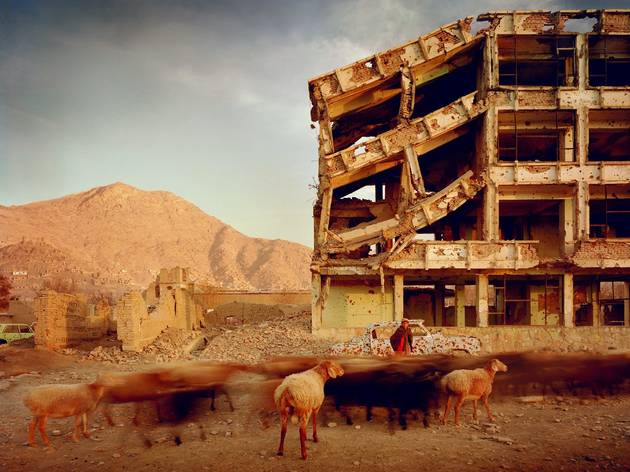 Simon Norfolk (Bullet-scarred apartment building and shops in the Karte Char district of Kabul. This area saw fighting between Hikmetyar and Rabbani and then between Rabbani and the Hazaras  2003)