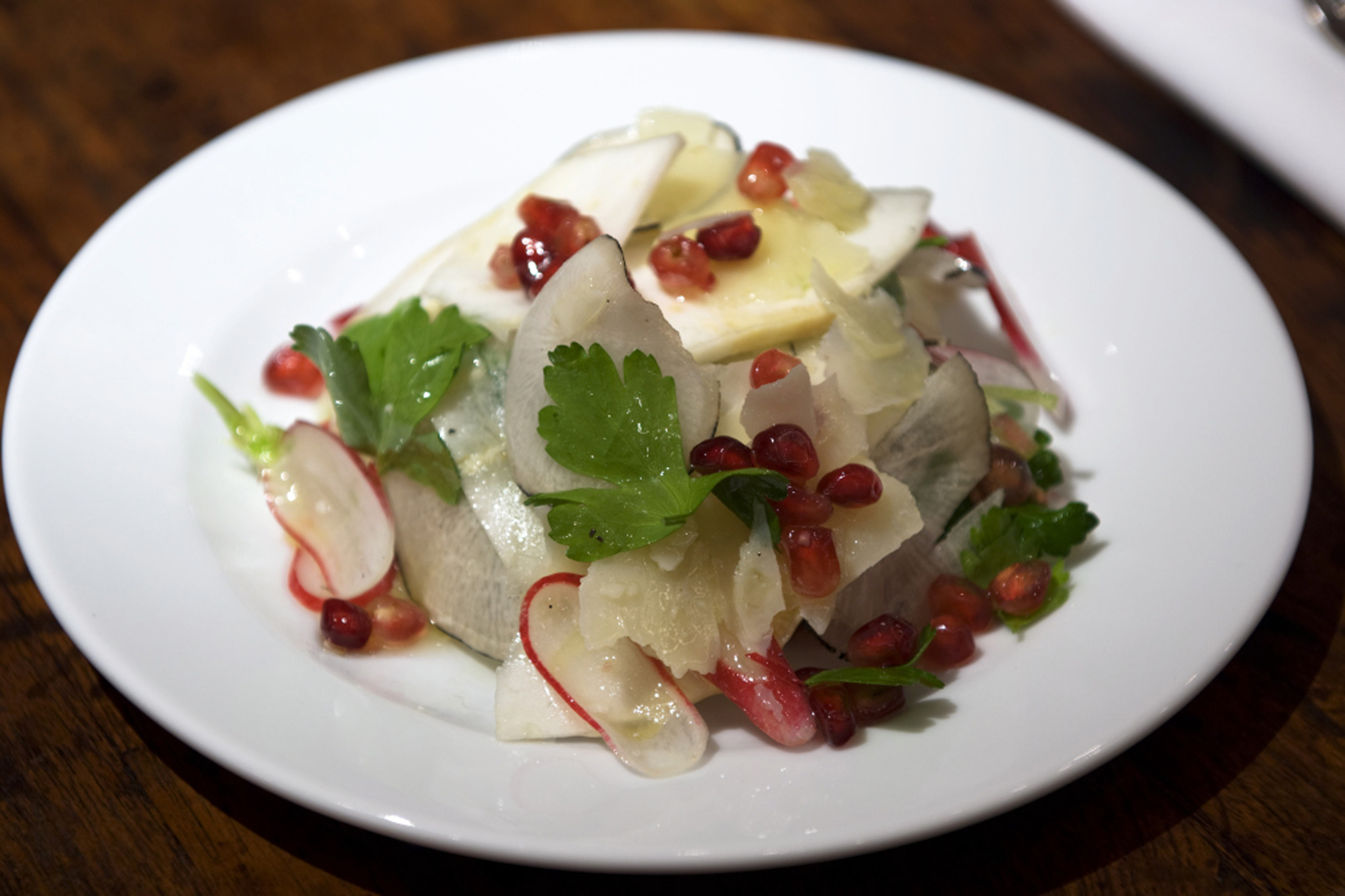 Radish, celeriac, pomegranate and pecorino salad with truffle dressing at Bocca di Lupo