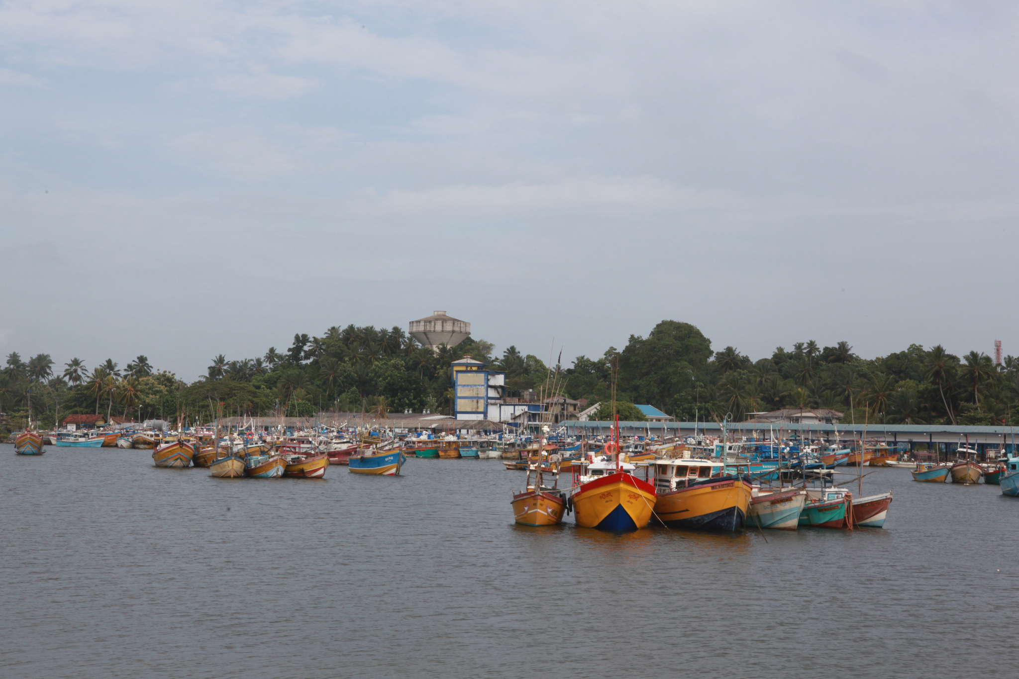 Colourful fishing boats complete the beach landscape