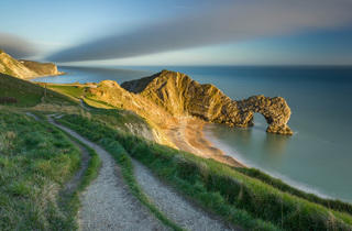 (The last of the evening light on Durdle Door, Jurassic Coast, Dorset, England by Jake Pike – Winner, Youth Classic view 2014)
