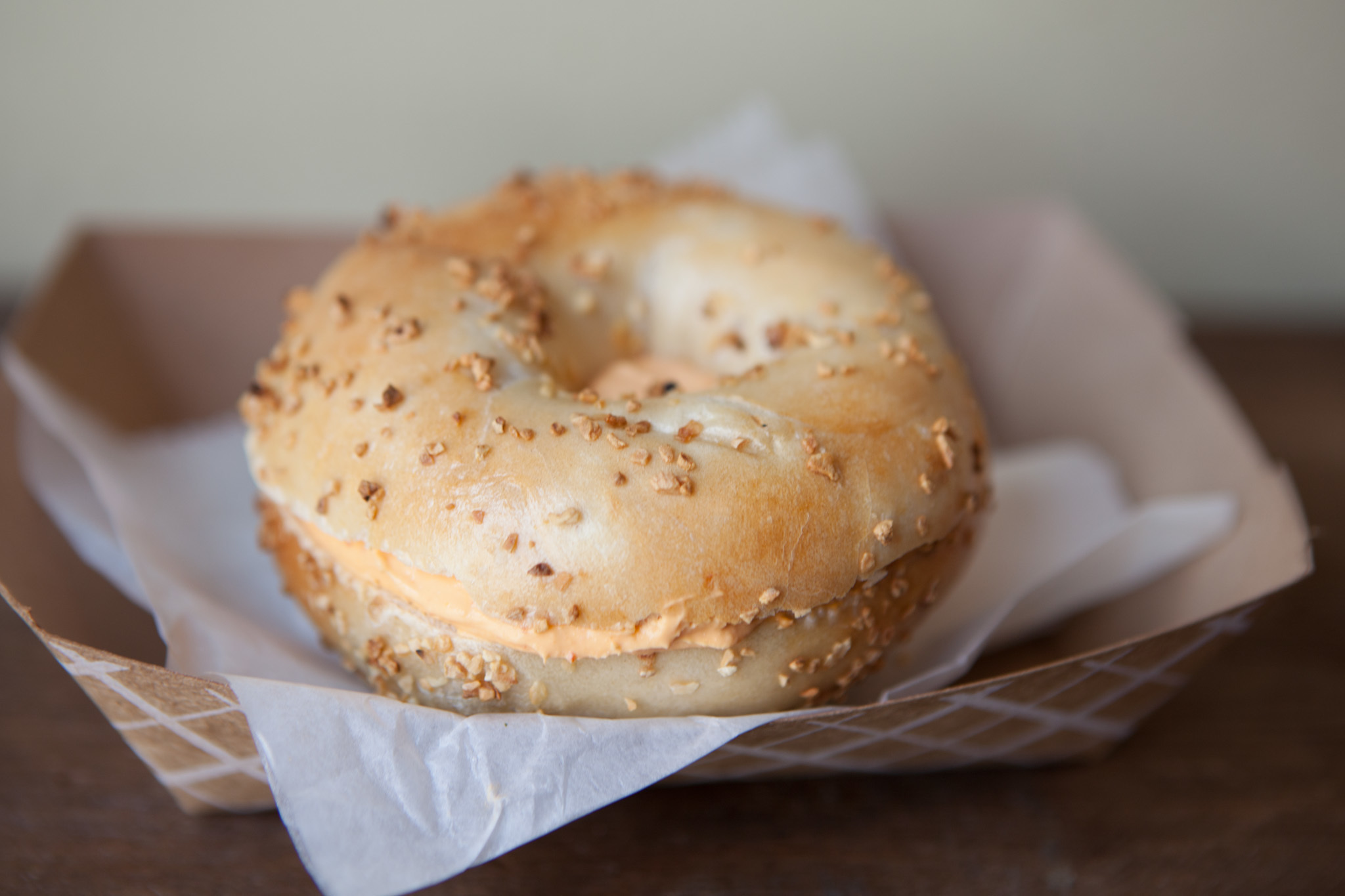 Garlic bagel with sriracha spread at Brobagel