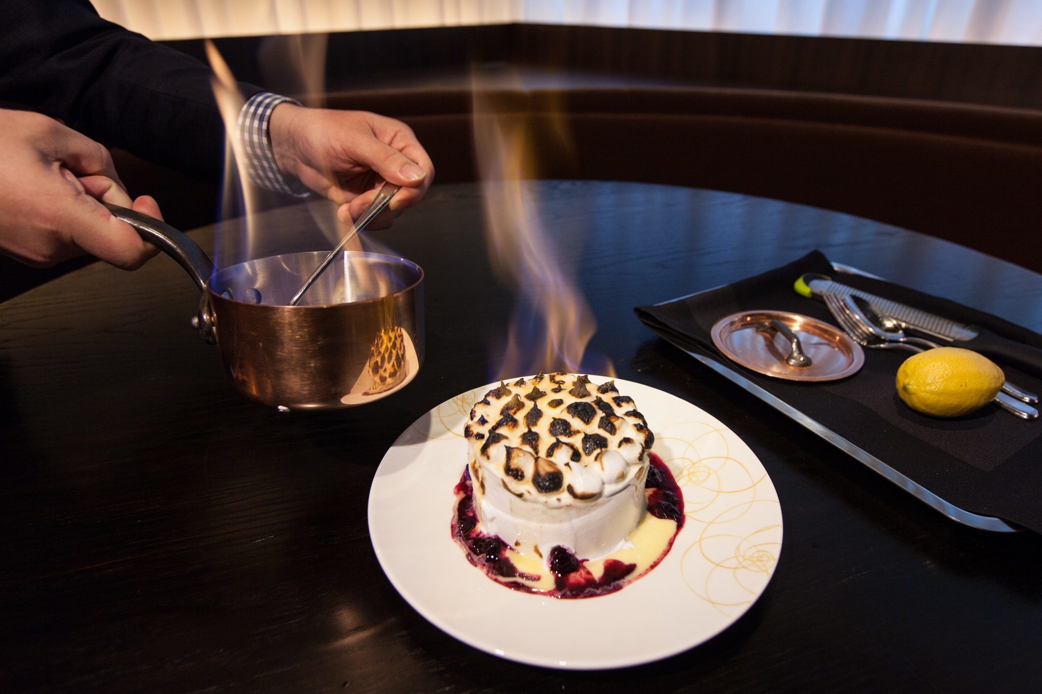 Baked Alaska at RPM Steak You need to order the baked Alaska as much for the presentation—set ablaze next to your table—as for the flavor. Filled with lemon sorbet, it's the love child between baked Alaska and lemon meringue pie. $11.