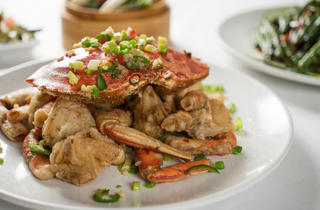 Spicy & salted crab at Silver Seafood Bring a friend and get messy with a massive Dungeness crab, which is broken apart, deep-fried and tossed with onions and peppers. We wound up with crab in our hair, but who cares? $36.
