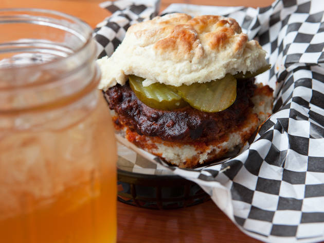 "Nashville hot chicken sandwich at The Roost Carolina Kitchen ""Hot"" is a laughable understatement—this fried-to-order sandwich, served on the most buttery biscuit in town, is positively incendiary. Add cooling cucumber slaw to the sandwich to help dull th"