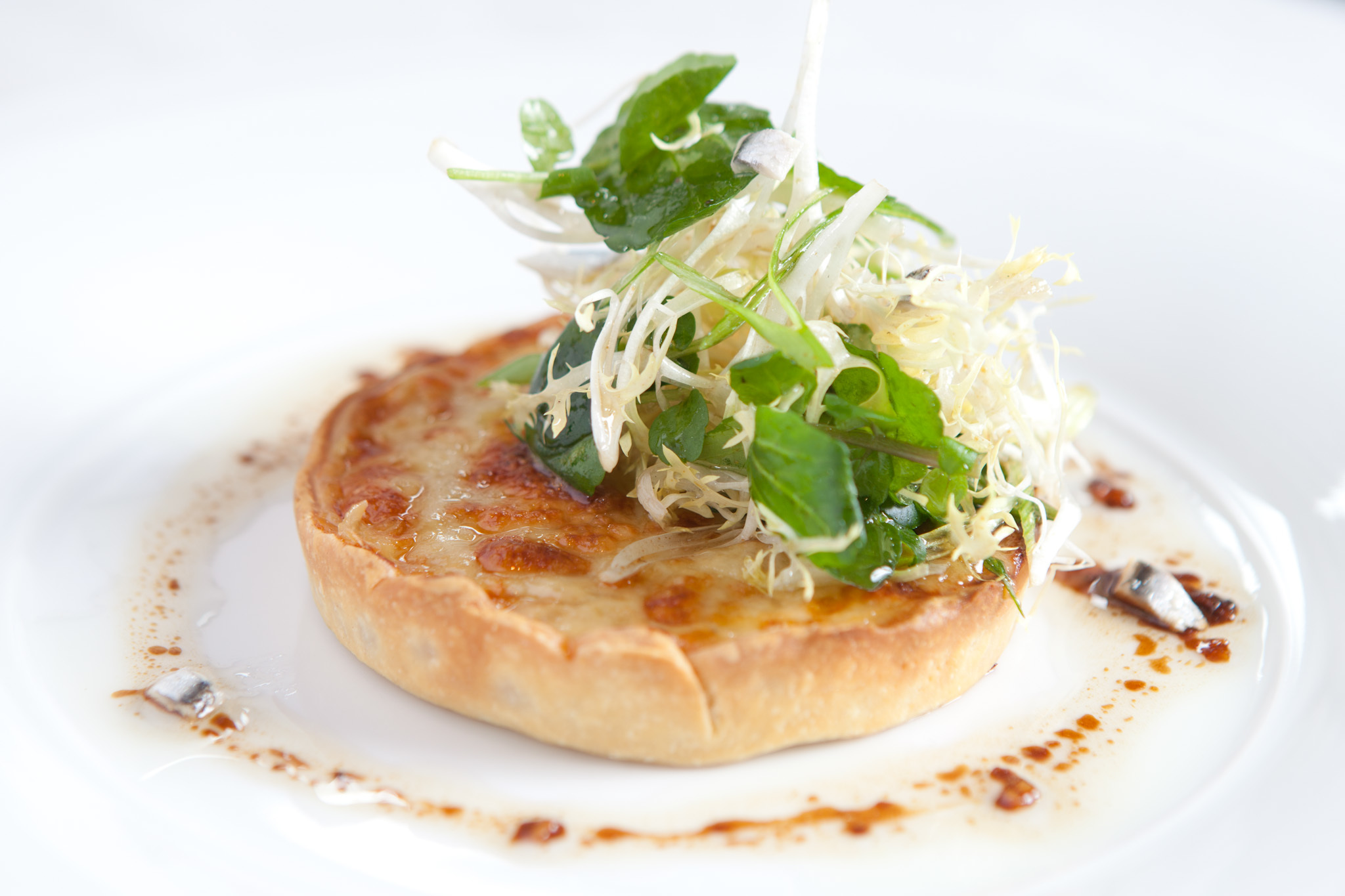 Onion tart at Next Restaurant Paris Bistro.