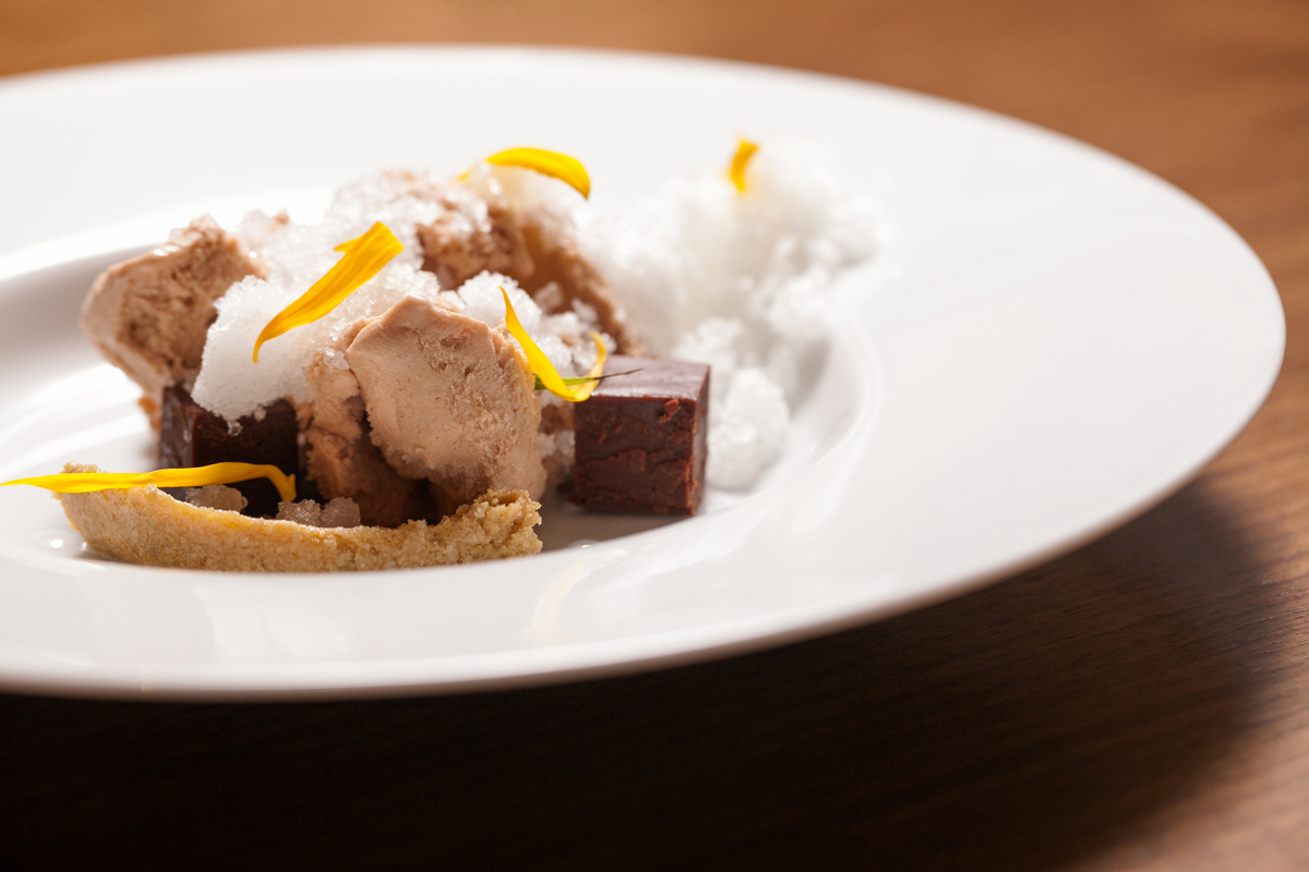 Kombucha, juniper snow, chocolate, sunflower dish at Intro
