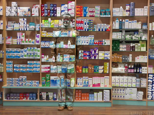 Liu Bolin, Hiding in the City - Paris, Pharmacy, 2014