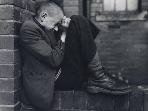 (Chris Killip: 'Youth, Jarrow', 1976, © the artist. Part of Hannah Starkey's display)