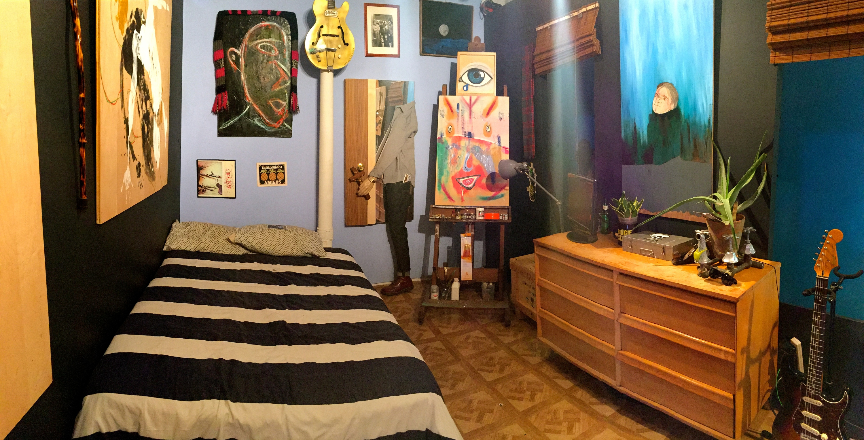 Artist doesn't have go far to get to his show; his bedroom is in the gallery