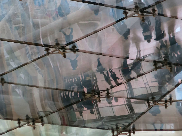 Shoppers reflected in the Bullring ceiling