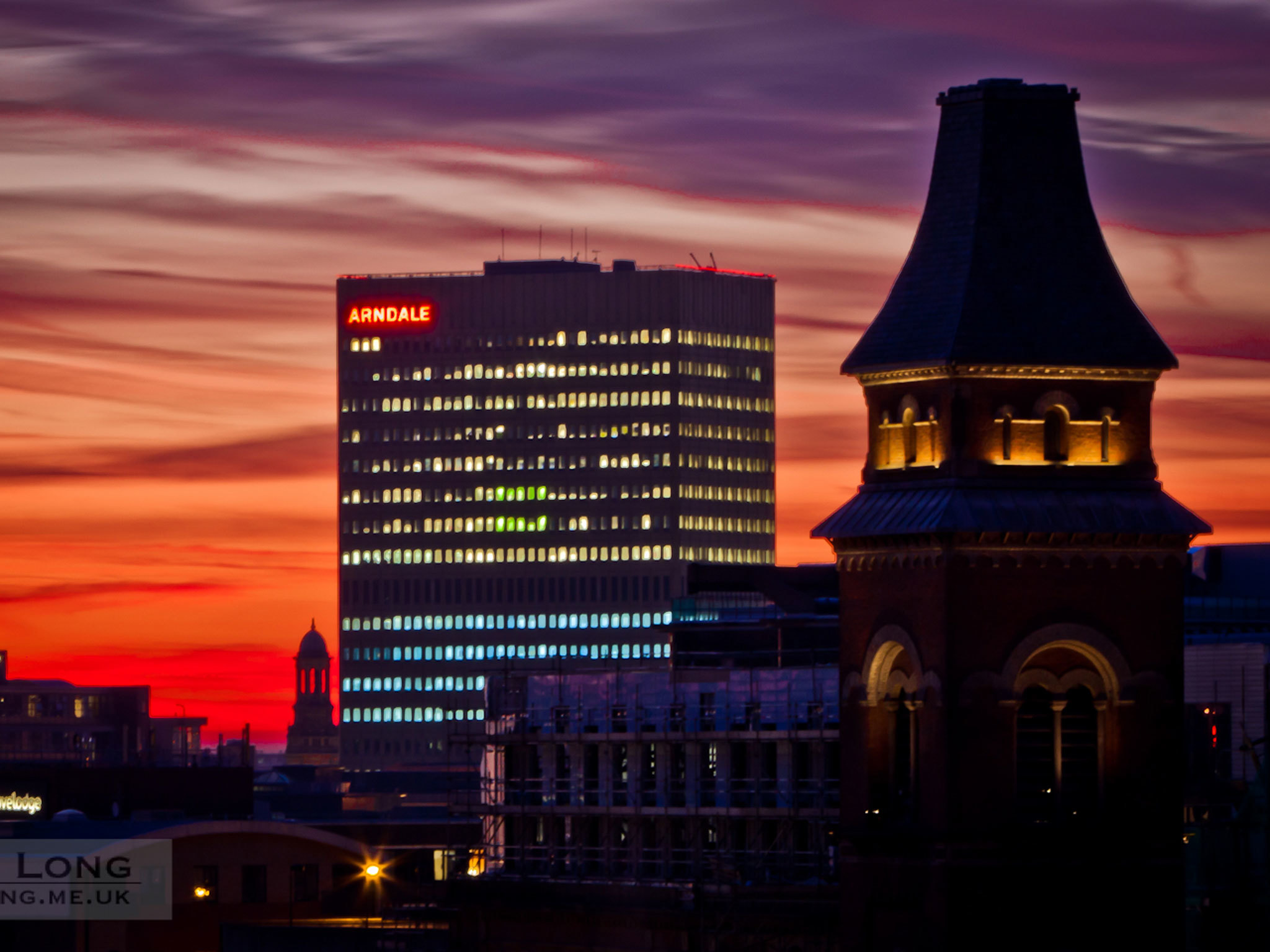 Photo of the Manchester skyline at sunset