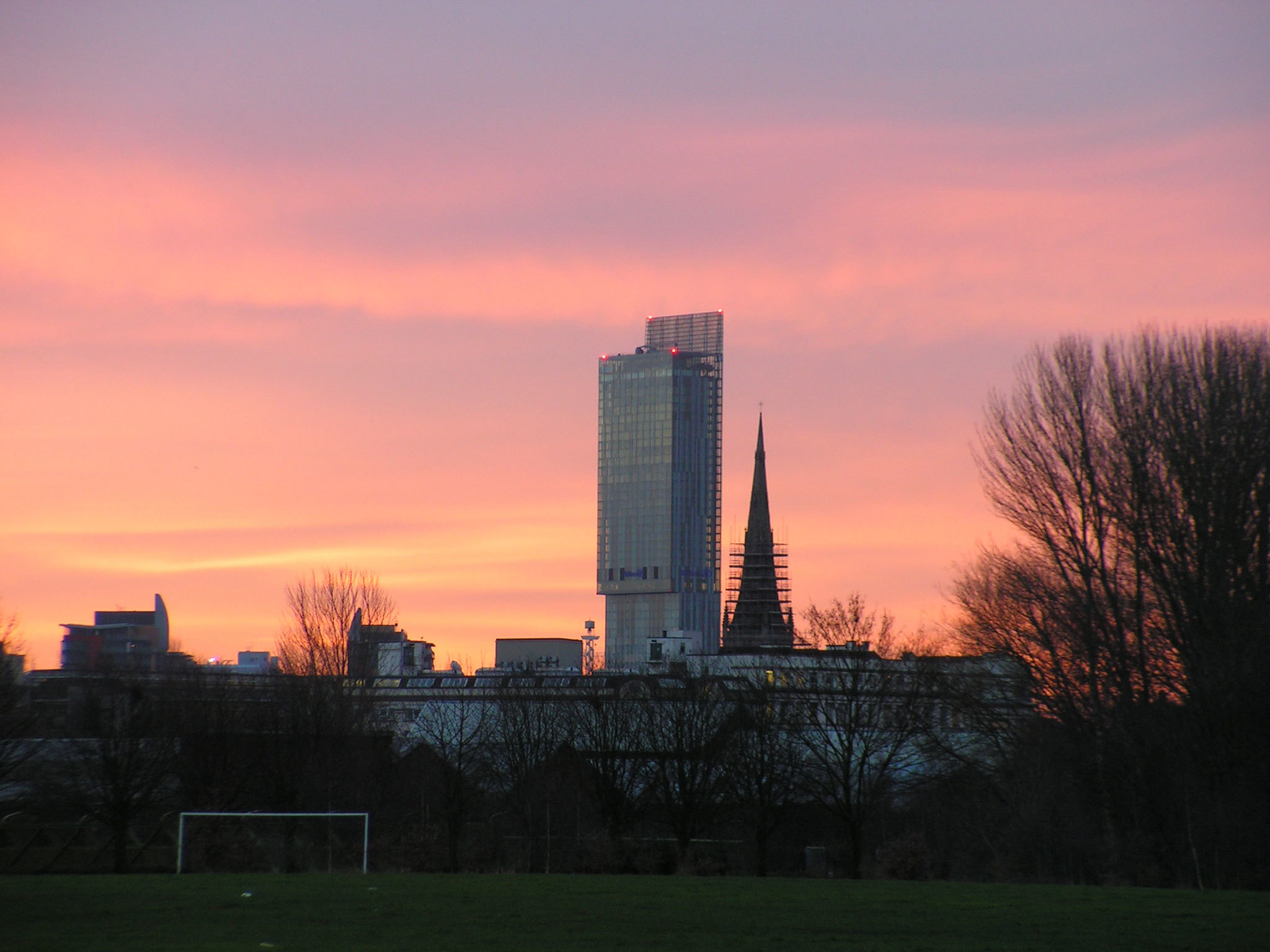 Photo of the Manchester skyline at sunrise