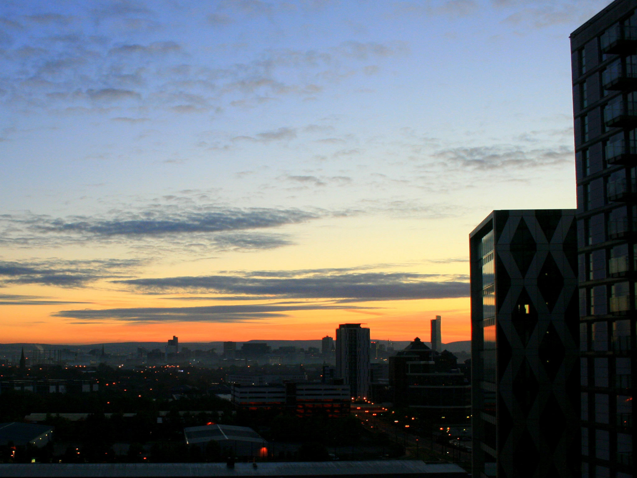 Photo of the Salford skyline at sunrise