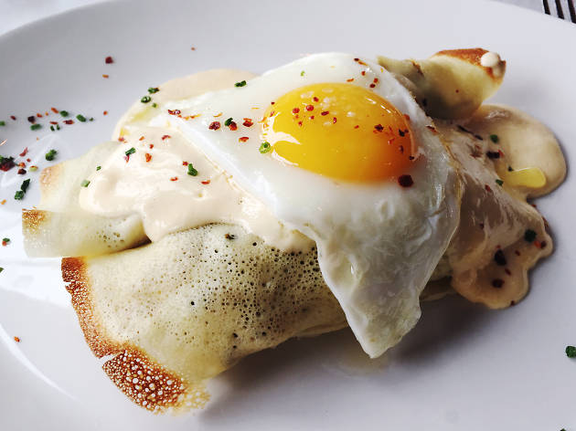 A10's brunch menu includes veggie crepes topped with cheese sauce and a fried egg.