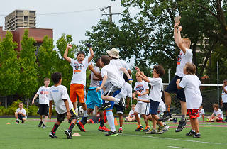 Kids sharpen their football skills at the Chicago Bears summer camp.