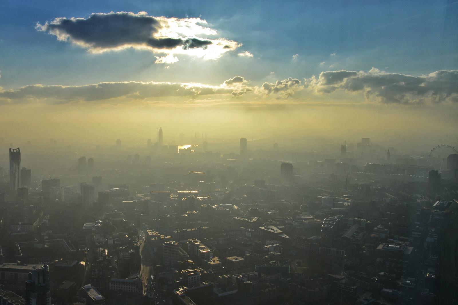 London's skyline in hazy sunlight.