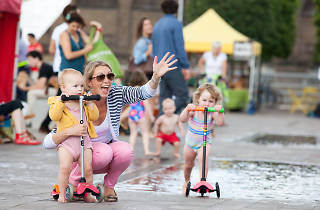 A family plays in Granary Square fountains, london