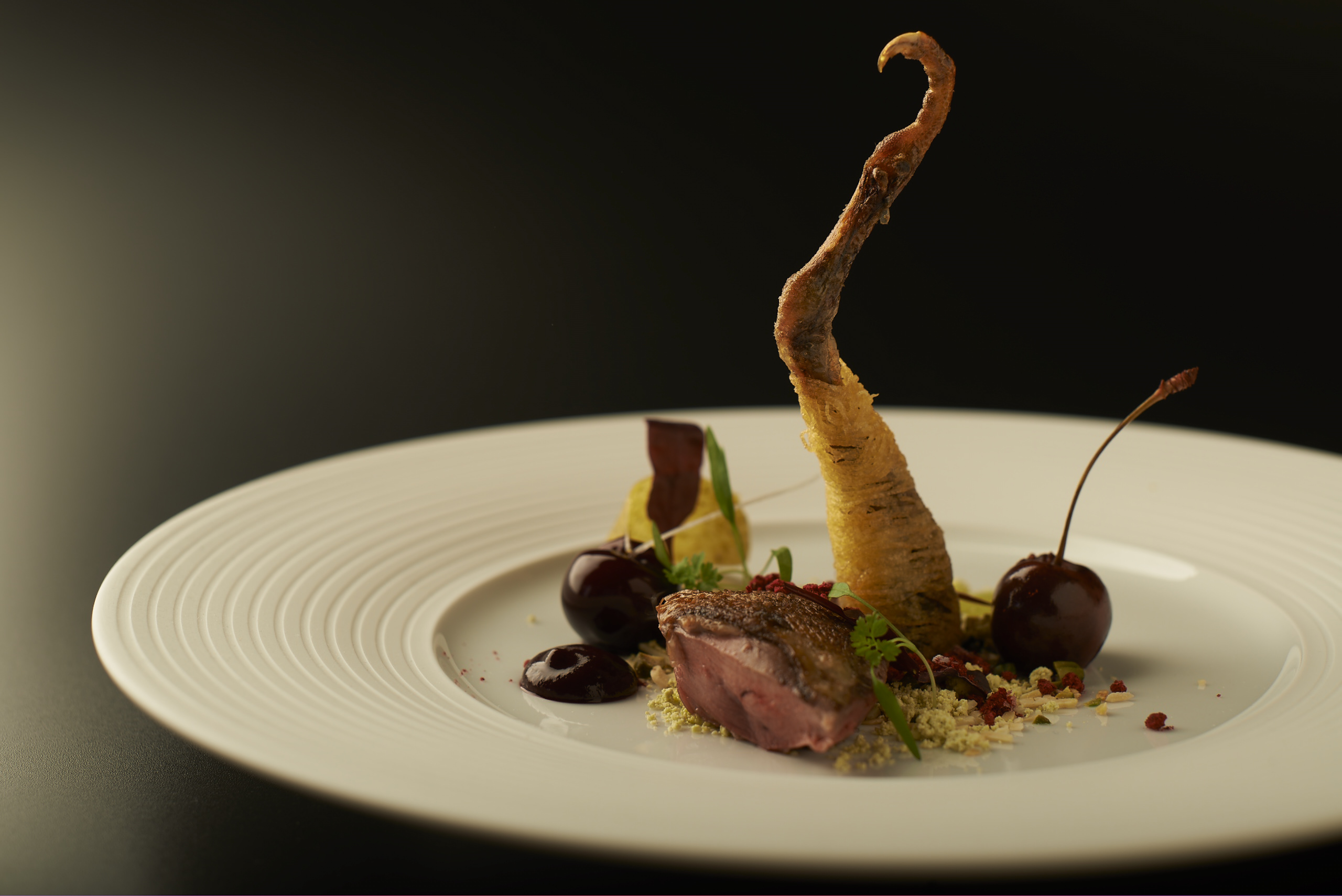 Squab pigeon with cherries, pistachio and violet mustard at Manchester House