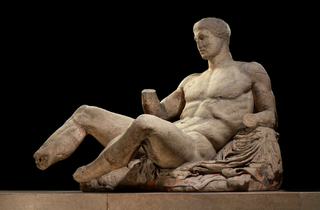 (A figure of a naked man, possibly Dionysos. Marble statue from the East pediment of the Parthenon. © The Trustees of the British Museum.)