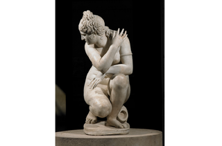 (Marble statue of a naked Aphrodite crouching at her bath, also known as Lely's Venus. Roman copy of a Greek original, 2nd century AD. Lent by Her Majesty the Queen)