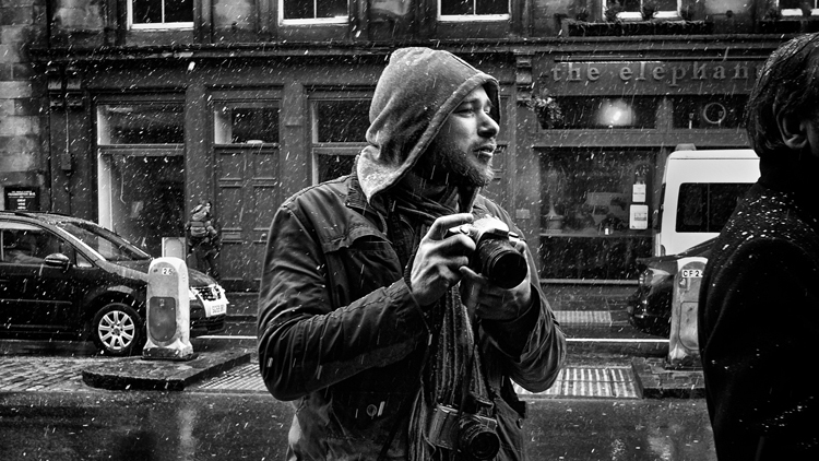 photographer in the rain