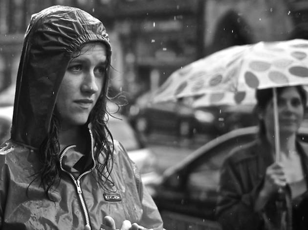 woman in raincoat umbrella