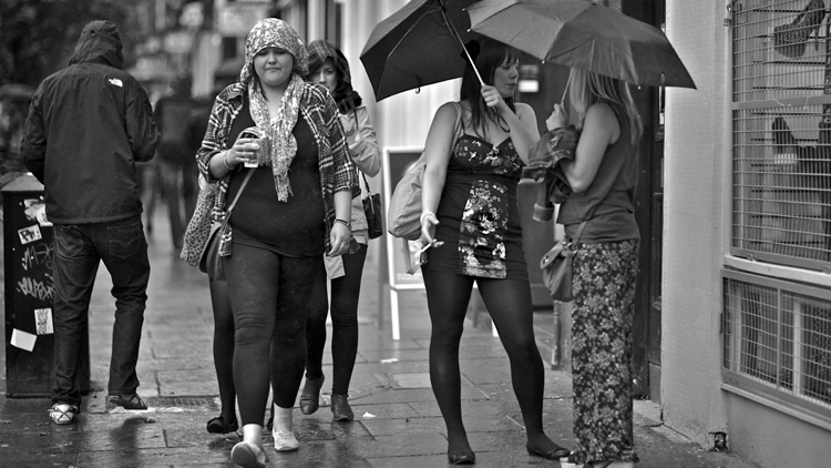 wet umbrella rainy pedestrians