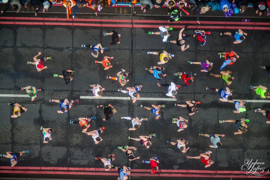 Runners in the London Marathon as viewed from the glass walkway on Tower Bridge.