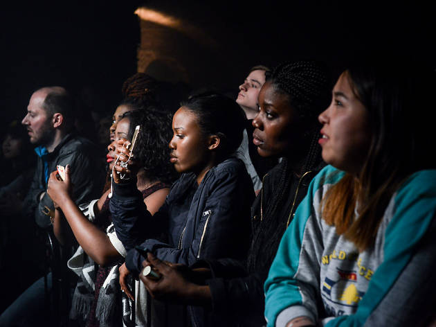 Gig goers watch George the Poet perform live at Village Underground, east London.