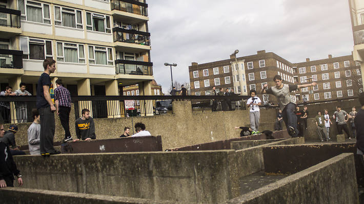 Teenage boys practice parkour (or 'free running') in Vauxhall, London.