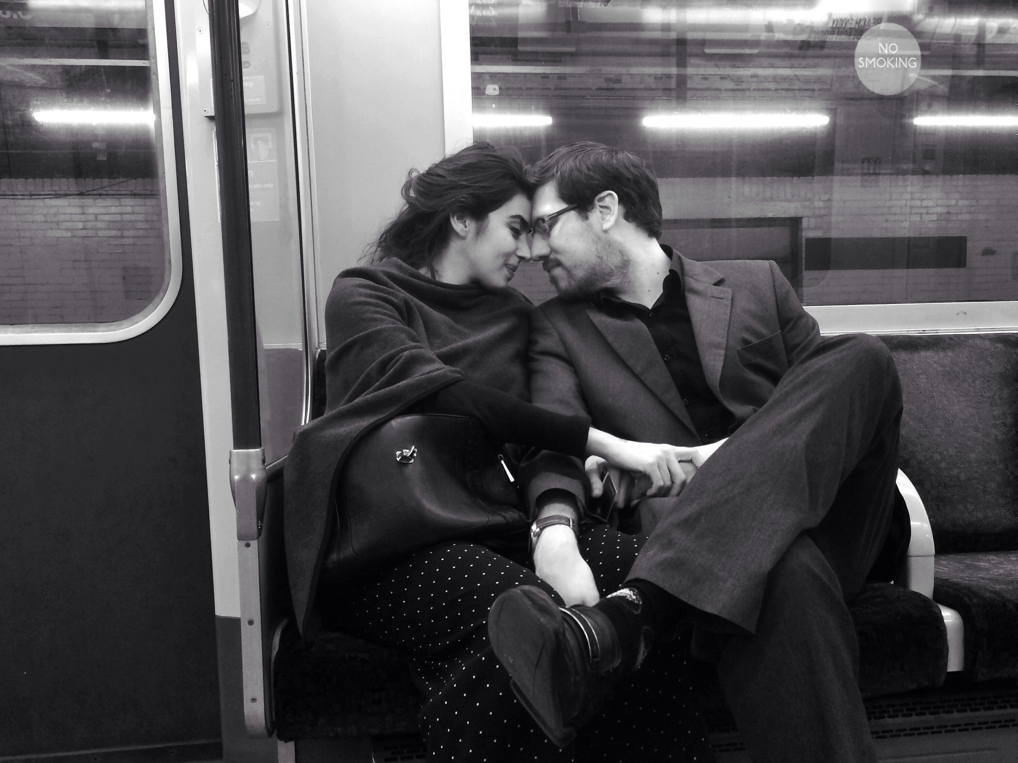 Two tube travellers rub noses on the District line.